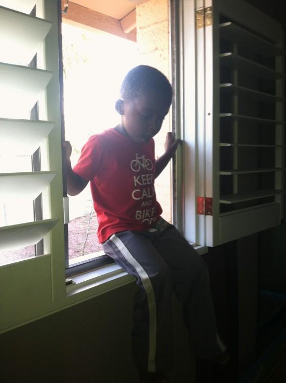 Mommy Ezra's stuck in the window